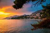 sunset above Adriatic sea and coastline in Brela - 220138638