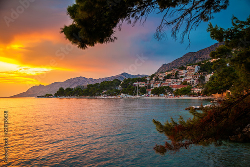 sunset above Adriatic sea and coastline in Brela - 220138638