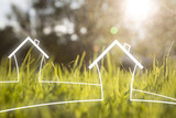 Artistic eco healthy living house symbols on sunny blurred meadow background. - 220148222