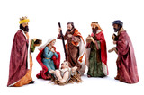 Christmas nativity scene with the Holy Family and the three wise men, isolated on white background - 220157622