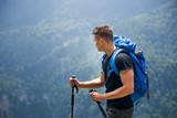 Active male hiker enjoying at mountain