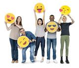 Diverse happy people holding happy emoticons