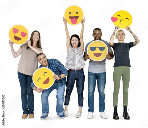 Leinwanddruck Bild Diverse happy people holding happy emoticons