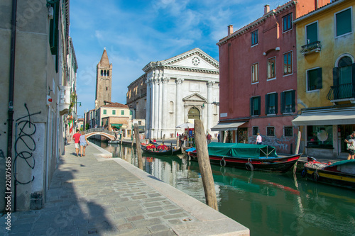 Fototapeta View of a pittoresc water channel in Venice Italy