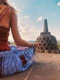 Young woman practicing yoga - meditation on the biggest Buddhist temple - Borobudur. - 220188824
