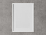White rectangular vertical frame hanging on a white wall mockup 3D rendering - 220198481