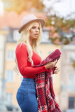 beautiful young blond woman spending time in the autumn scene - 220202661