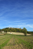 Looking up at picturesque hilltop town of Tournon d'Agenais in rural Lot et Garonne countryside, France - 220206434