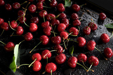 juicy sweet cherry on a black background