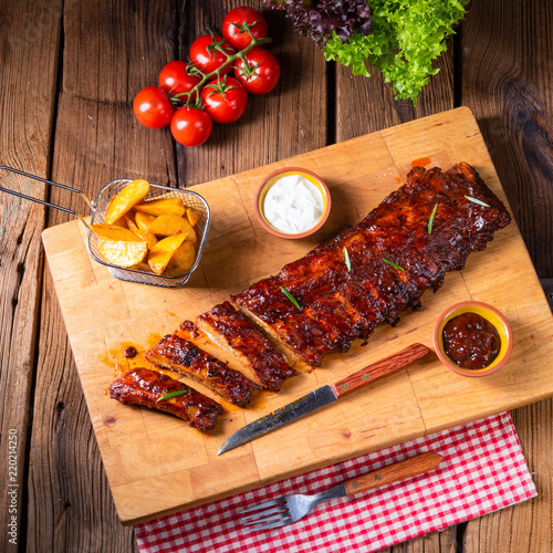 BBQ spare ribs from a charcoal grill - 220214250