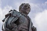 Edinburgh, Scotland, UK - June 14, 2012; Fish eye shot on chest and head of Statue of Walter Montagu Douglas Scott, Duke of Buccleuch on Parliament Square. cloudscape. - 220241007
