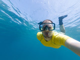 Male diver taking a selfie while snorkling. - 220247265