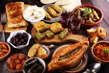 Middle eastern or arabic dishes and assorted meze, concrete rustic background. sambusak. Turkish Dessert Baklava with pistachio. Sarma. Halal food. Lebanese - 220248009