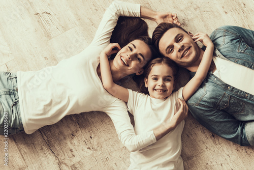 Happy Family Lying of Floor Together at Home - 220259643
