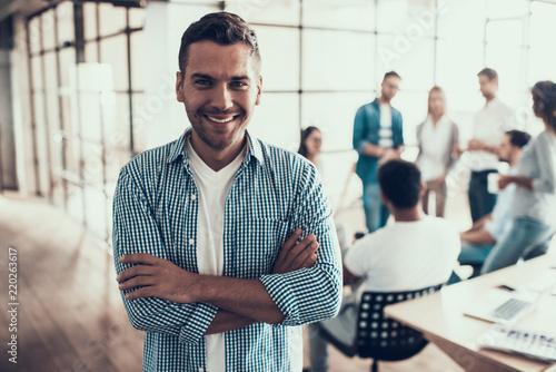 Leinwandbild Motiv Portrait of Young Smiling Businessman in Office