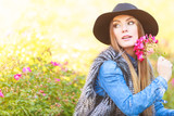 Beauty woman with flowers - 220273420