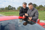 pilot and engineer checking last races performances durint tests