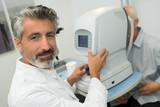 handsome optometrist during consultation in ophthalmology clinic - 220309698