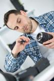 technician repairing dslr lense - 220309847