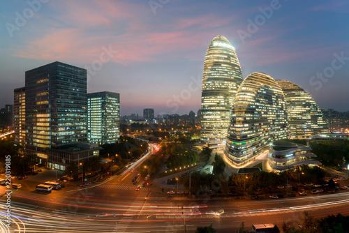 Fototapeta WangJing Soho business district at night in Beijing, China.