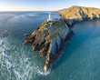 Leinwanddruck Bild - Aerial view of the beautiful cliffs close to the historic South Stack lighthouse on Anglesey - Wales