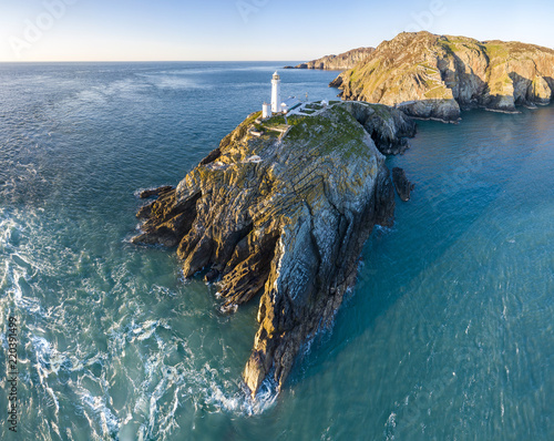 Leinwanddruck Bild Aerial view of the beautiful cliffs close to the historic South Stack lighthouse on Anglesey - Wales