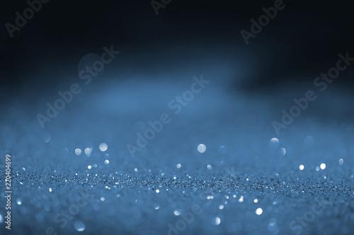 blurred blue glowing glitter on black background