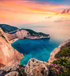 Leinwandbild Motiv Fabulous spring scene on the Shipwreck Beach. Colorful sunset on the Ionian Sea, Zakinthos island, Greece, Europe. Beauty of nature concept background. Artistic style post processed photo.