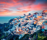 Impressive evening view of Santorini island. Picturesque spring sunset on the famous Greek resort Oia, Greece, Europe. Traveling concept background. Artistic style post processed photo. - 220410476