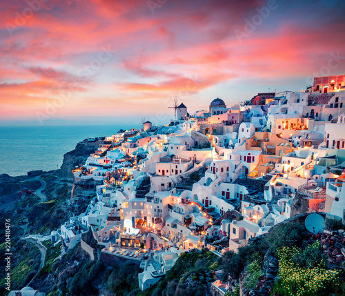 Impressive evening view of Santorini island. Picturesque spring sunset on the famous Greek resort Oia, Greece, Europe. Traveling concept background. Artistic style post processed photo. © jojjik