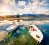 Sunny spring scene in the small fishing town - Mikrovivos. Splendid morning seascape of Aegean sea. Beauty of countryside concept background, Greece, Europe. Artistic style post processed photo. - 220411091