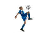 Young boy with soccer ball doing flying kick, isolated on white. football soccer players in motion on studio background. Fit jumping boy in action, jump, movement at game. - 220414062
