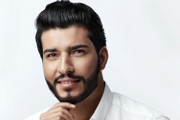 Hair And Beard. Beautiful Smiling Man With Hair Style © puhhha