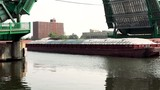Barge passing under drawbridge on a river - 220427614