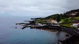 Aerial shot towards the coast at Manadas in Sao Jorge Island, Azores. Portugal - 220430252