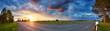 Leinwanddruck Bild - black asphalt road and white dividing lines at sunset