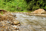 View on a mountain river with stony banks in rainforest. Chiang Dao, Thailand.