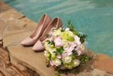 bouquet and shoes on the background of water. wedding - 220439206