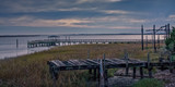 Broken and Rotting Piers Over Marshland - 220449870