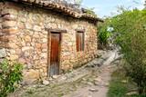 old stone house with wooden door in Igatu, Chapada Diamantina, Bahia, Brazil - 220460465