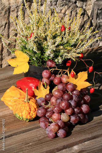 Picturesque small decoration in farm in Poland.  Vegetable with heathers composition. Autumn crops, harvest festival at the end of summer.  - 220479212
