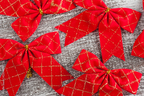 Red bows on white wooden background