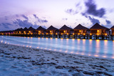 Maldives bungalow in the ocean with long exposure in evening - 220487425