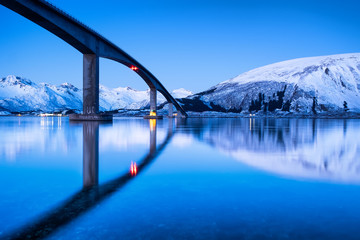 Bridge and reflection on the water surface. Natural landscape in the Lofoten islands, Norway. Architecture and landscape. © Biletskiy Evgeniy