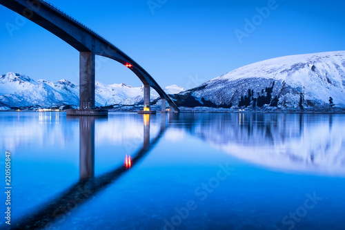 Bridge and reflection on the water surface. Natural landscape in the Lofoten islands, Norway. Architecture and landscape. - 220505847