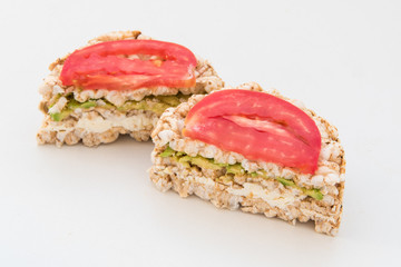 round crispbreads with tomatoes avocado and chees