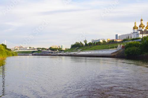 The suspension bridge and Tura River Embankment in Tyumen, Russia.