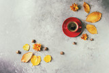 Red cup of black coffee decorated by yellow autumn leaves, aster flowers and acorns over grey texture background. Flat lay, space. Seasonal background. Heart shape on foam - 220507272