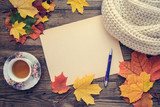 Toned picture with autumn leaves, a cup of tea and a notebook - 220510696