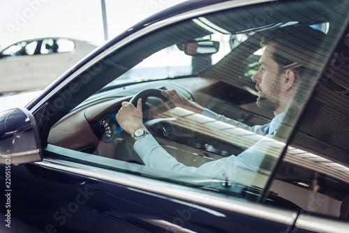 Fototapeta businessman in driving car